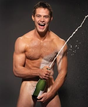 Sexy man with bottle of champagne